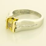 Man made radiant cut 1.57ct. yellow diamond ring