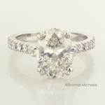 3.00ct. oval cut diaond solitaire with diamond accents, copyrighted original from Thomas Michaels Designers, Inc.