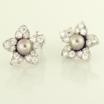 Black pearl 6.5mm and 1.80ct. pavé diamond earrings floral motif