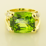 28ct. cushion cut peridot ring with diamond pavé accents