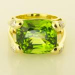28ct. cushion cut peridot ring with diamond pavé accents