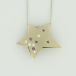 White gold and white and purple color diamond star pendant.