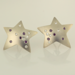White gold and white and purple color diamond star earrings