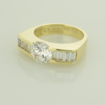 Baguette 1.20ct. and Round 2.00ct. diamond 18KT yellow gold ring set with 2.00ct. center 1.20ct