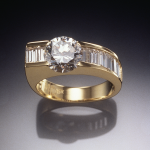 Diamond and 18KT gold ring set with 2.00ct. center with 1.35ct. diamond baguette accents