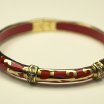 18KT Yellow Verneil on Sterling Silver and red Acrylic swirl motif Braclet