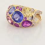 Sapphire (6.75cts.) and Diamonds (.75ct.) set in 18KT yellow gold confetti ring