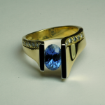 18KT gold and blue oval (1.50ct.) sapphire and diamond ring