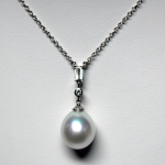 South Sea 15mm pearl platinum pendant with diamond accents.