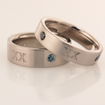 18KT white gold wedding bands with XX motif and accent diamonds