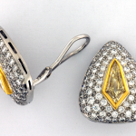 Natural fancy yellow kite shape 2.34cts. diamonds and pavé 3.19cts. diamond earrings