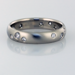 Wedding Band In White Gold with a scatter of diamonds