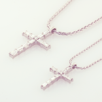 Platinum and diamond crosses on platinum wheat chains large set with 1.20ct. and small .55ct.