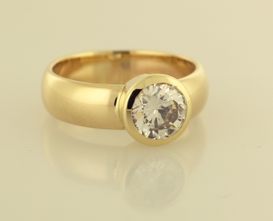 Solitaire ring bezel set in 14KT yellow .75 view