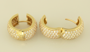 Diamond and gold huggy earrings set with 3.00ct. diamonds
