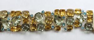 Gemstone multi link bracelet. opened and flat, close up