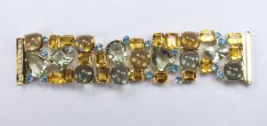 Gemstone multi link bracelet. opened and flat