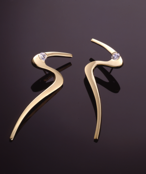 "Gold and diamond (.50ct) ""S"" earring"