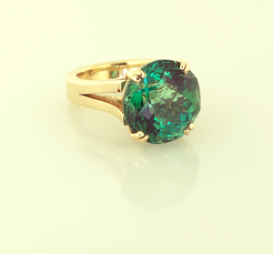 18KT gold and green tourmaline (16.00ct.) hand fabricated ring