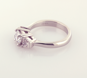 Three Stone ring with round center and trapezoid side diamonds