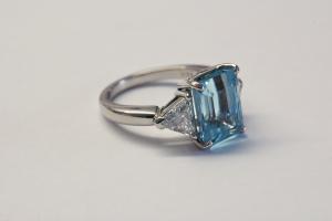 6.50ct. Aquamarine and .60ct. trillion diamond three stone platinum ring