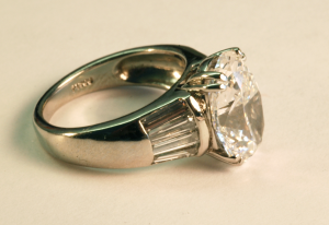 5.00ct. oval diamond and baguette side diamonds set in platinum