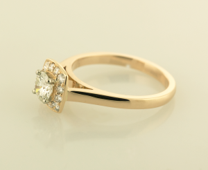 Rose gold surround diamond solitaire side view