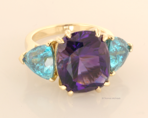Three Stone Ring with Amethyst and Blue Zircon .75 View