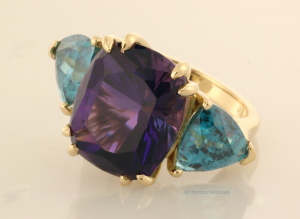 Three Stone Ring with Amethyst and Blue Zircon .75 Viewe