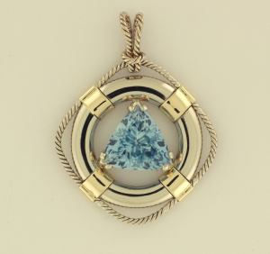 Aquamarine 4.04ct Trillion cut, set in 14KT white and yellow gold life preserver pendant