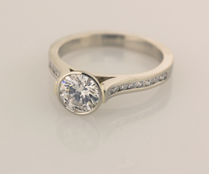 bezel set center, cathedral ring with .15ct channel set diamonds 3/4 view view