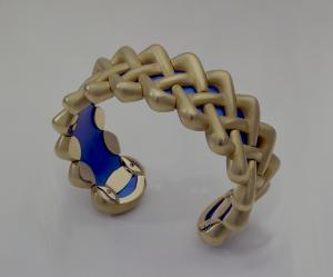 18 kt green gold and titanium Celtic braid bracelet