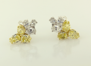 White and yellow diamond cluster earrings.