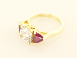 Three Stone Ring with 3.01ct Dia and side rubies in 18KT Yellow side view