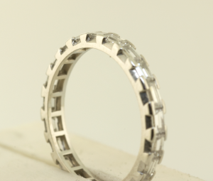 Diamond baguette eternity band prong and channel set, close up view