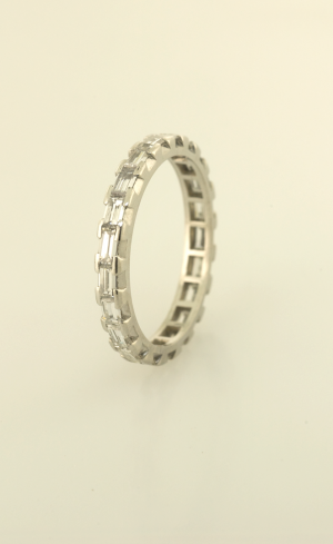 Diamond baguette eternity band prong and channel set, side view