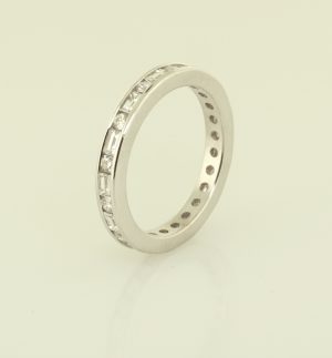 Platinum and diamond eternity band set with round, baguetted diamonds 3/4 view