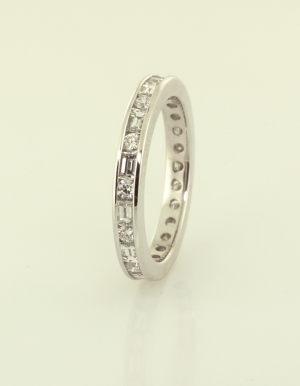 Platinum and diamond eternity band set with round, baguetted diamonds side view