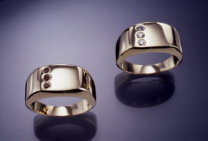 14KT yellow gold gents rings set each set with .15ct. diamonds