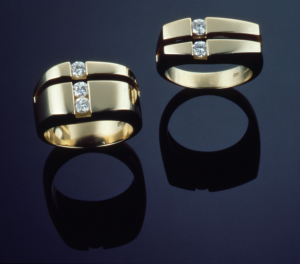 14KT yellow gold rings one set with .40ct. and one with .60ct.