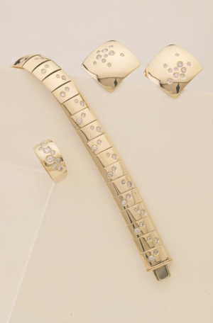 Diamond and gold celestial collection linked bracelet, earrings and ring