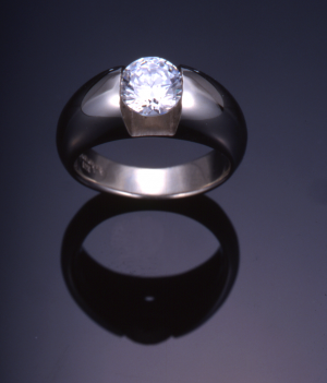 White gold and channel set diamond (1.00ct.) solitaire ring