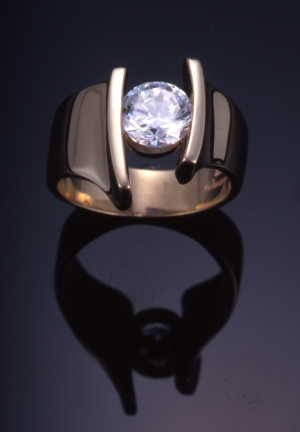 18KT gold and round diamond (1.50ct.) contemporary ring set with 1.50ct.