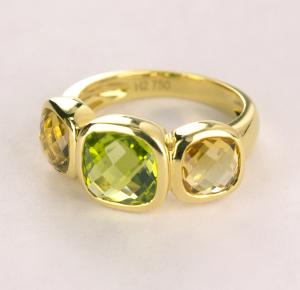 Citrine bezel set three stone ring in 18KT yellow gold