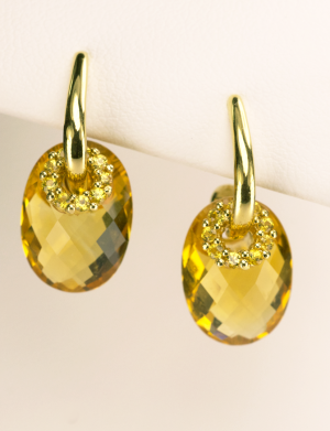 Oval Citrine Earring in 18KT yellow gold with yellow sapphire accents.