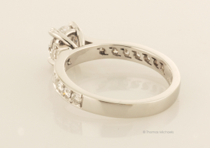 Platinum and Diamond Solitaire with Accent Diamond Pavé Back View