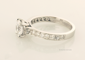 Platinum and Diamond Solitaire with Accent Diamond Pavé Side View