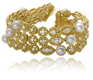 Diamond and pearl three row bracelet set in 18KT yellow gold