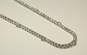 In Line Diamond Necklace with Larger Center Diamonds