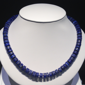 Large Lapis Lazuli heishi style beads with 14KT yellow gold catch.